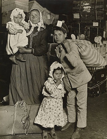 Immigrant Family Arriving in the U.S. Pictured in the Baggage Room of Ellis Island - 1905